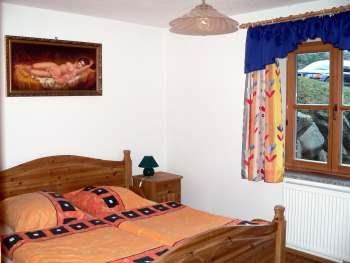 Schlafzimmer im Ferienhaus für Angelurlaub