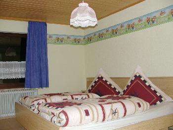 Schlafzimmer Ferienwohnungen auf dem Bauernhof bei Michelsneukirchen